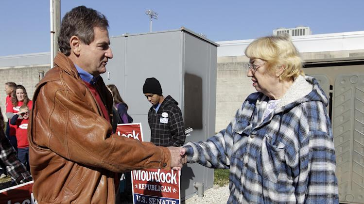 Republican Richard Mourdock, a candidate for Indiana's U.S. Senate seat, greets voters and supports outside a polling place in Indianapolis, Tuesday, Nov. 6, 2012.  Mourdock is running against Democrat Joe Donnelly. (AP Photo/Michael Conroy)