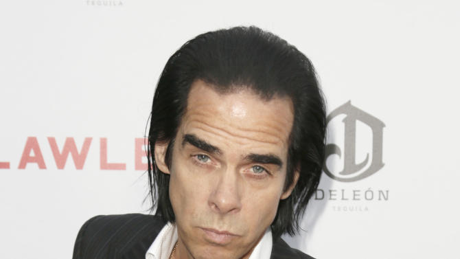"""FILE - This Aug. 22, 2012 file photo shows Nick Cave attending the LA premiere of """"Lawless"""" at Arclight Cinemas Hollywood in Los Angeles. Cave, the Australian singer-songwriter, has gradually expanded beyond music into fiction, poetry and screenwriting. """"Lawless,"""" which stars Shia LaBeouf and Tom Hardy, is his second film with director John Hillcoat following the even bloodier Aussie Western """"The Proposition.""""  (Photo by Todd Williamson/Invision/AP, file)"""