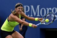 Victoria Azarenka of Belarus returns against Samantha Stosur of Australia during their 2012 US Open women's singles match at the USTA Billie Jean King National Tennis Center in New York