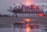 A FedEx Boeing 777 aircraft taxis on the runway carrying two giant pandas bound for France at Chengdu airport, on January 15. Yuan Zi and Huan Huan left early Sunday to their new home at the Beauval zoo in France
