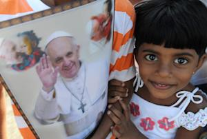 A Sri Lankan girl waits for Pope Francis' arrival …