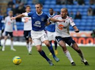 Bolton Wandererers' Darren Pratley (R) takes on Everton's Leon Osman during their FA Cup fourth round match at the Reebok Stadium in Bolton on January 26, 2013. Everton won 2-1