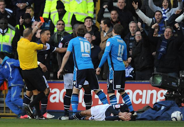 Leeds' Luke Varney, right, is shown a red card by referee Mark Halsey, left