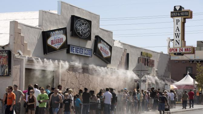 Customers wait in a line that stretches down the block to enter the Gold and Silver Pawn Shop, Wednesday, April 3, 2013, in Las Vegas. Pawn sales at the shop, which is featured in the television reality show Pawn Stars, bring in about $20 million a year, up from the $4 million a year it made before the show aired. Turning small business owners into stars has become a winning formula for television producers, but the businesses featured in the shows are cashing in, too. Sales explode after just a few episodes have aired, transforming nearly unknown small businesses into household names. (AP Photo/Julie Jacobson)