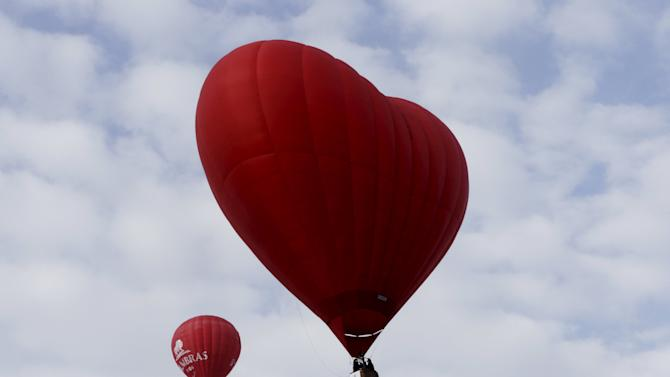 "A heart-shaped hot air balloon flies in the sky during the ""Love Cup 2016"" event, ahead of Valentine's Day, in Jekabpils"