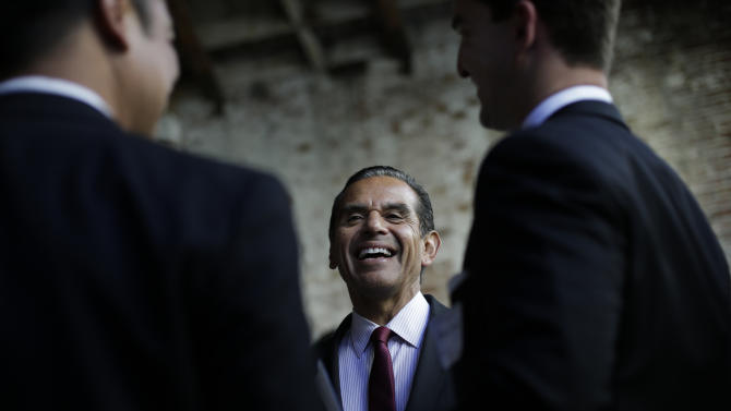Los Angeles Mayor Antonio Villaraigosa chats with well-wishers during a groundbreaking ceremony for the La Kretz Innovation Campus in Los Angeles, Wednesday, June 19, 2013. Mayor Antonio Villaraigosa leaves office July 1 after an eight-year run at City Hall that began full of promise and ends with mixed results. (AP Photo/Jae C. Hong)