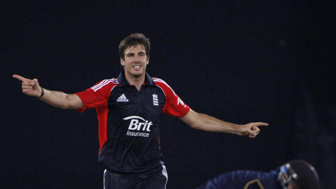 England XI cricketer Steven Finn celebrates the dismissal of Hyderabad XI batsman Ravi Teaja, left, during a practice match in Hyderabad, India, Saturday, Oct. 8, 2011. (AP Photo/Mahesh Kumar A.)