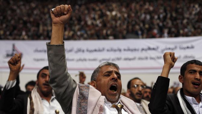 Followers of the Houthi movement shout slogans as they attend a gathering in Sanaa