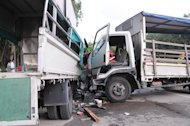 Two lorries collided along Tanah Merah Coast Road on Tuesday morning with 1 dead and 25 others injured. (Photo courtesy of SCDF)