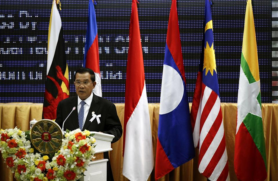 Cambodia's Prime Minister Hun Sen delivers his opening remarks for the 21st Association of Southeast Asian Nations, or ASEAN, Summit in Phnom Penh, Cambodia, Sunday, Nov. 18, 2012.  (AP Photo/Vincent Thian)