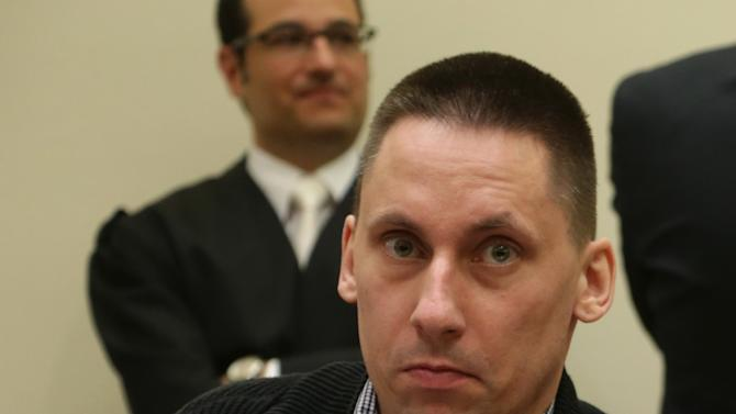 Ralf Wohlleben, alleged supporter of the neo-Nazi group National Socialist Underground (NSU), waits for the start of a trial in Munich, southern Germany, Monday, May 6, 2013. The highest-profile neo-Nazi murder trial in Germany in decades opened Monday amid tight security and intense media interest, with the five accused appearing in public for the first time since their arrest more than a year ago. Zschaepe, 38, is accused by prosecutor of complicity in the murder of eight Turks, a Greek and a policewoman between 2000 and 2007. If convicted she faces life imprisonment. Zschaepe is also accused of involvement in at least two bombings and 15 bank robberies carried out by her accomplices Uwe Mundlos and Uwe Boenhardt, who died in an apparent murder-suicide in November 2011. (AP Photo/Matthias Schrader)