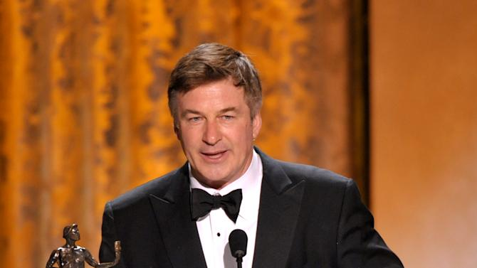 "Alec Baldwin accepts the award for outstanding male actor in a comedy series for ""30 Rock"" at the 19th Annual Screen Actors Guild Awards at the Shrine Auditorium in Los Angeles on Sunday Jan. 27, 2013. (Photo by John Shearer/Invision/AP)"