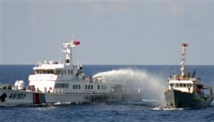 A Chinese coastguard vessel uses water cannon on a Vietnamese Sea Guard ship on the South China Sea near the Paracels islands