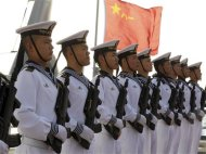 Chinese sailors stand at attention on the helipad of the Chinese frigate Yancheng docked at Limassol port, January 4, 2014. REUTERS/Andreas Manolis