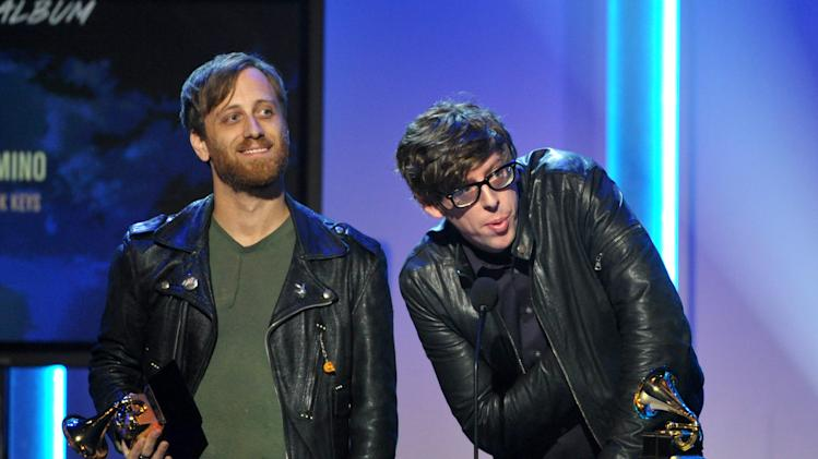 "Dan Auerbach, left, and Patrick Carney accept the award for best rock album ""El Camino"" at the 55th annual Grammy Awards on Sunday, Feb. 10, 2013, in Los Angeles. (Photo by John Shearer/Invision/AP)"