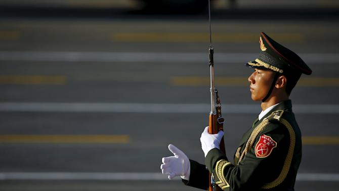 Soldier of the People's Liberation Army (PLA) of China holds his weapon at the Tiananmen Square before a military parade to mark the 70th anniversary of the end of World War Two, in Beijing
