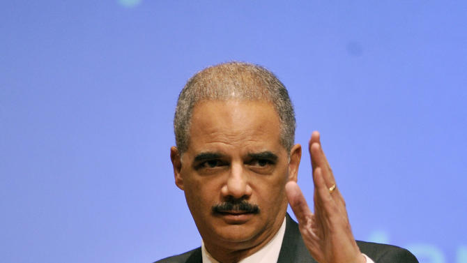 """Attorney General Eric Holder surveys the room before speaking at the Northwestern University law school, Monday, March 5, 2012 in Chicago.  Attorney General Eric Holder said Monday that the decision to kill a U.S. citizen living abroad who poses a terrorist threat """"is among the gravest that government leaders can face,"""" but justified lethal action as legal and sometimes necessary in the war on terror. (AP Photo/Brian Kersey)"""