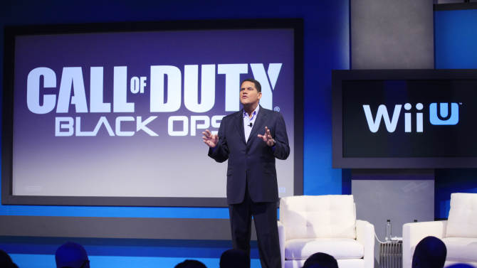 """Reggie Fils-Aime, president and chief operating officer of Nintendo of America, announces that """"Call of Duty Black Ops II"""" will be available for the upcoming Wii U gaming console, Thursday, Sept. 13, 2012 in New York. The gaming console will start at $300 and go on sale in the U.S. on Nov. 18, in time for the holidays, the company said Thursday. (AP Photo/Mark Lennihan)"""