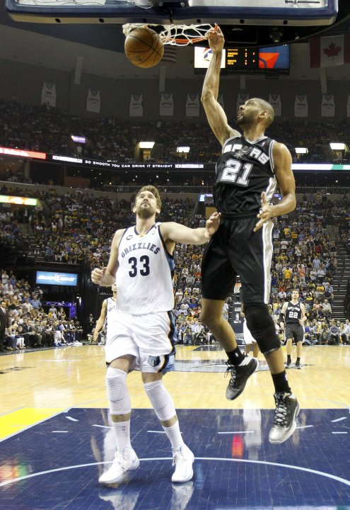 San Antonio Spurs' Tim Duncan dunks on Memphis Grizzlies' Marc Gasol during the second half in Game 3 of their NBA Western Conference final playoff basketball series in Memphis