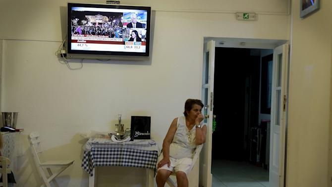 The results of the Greek referendum are shown on a television in the village of Meyisti on the Island of Kastellorizo which is the most easterly of the islands in Greece
