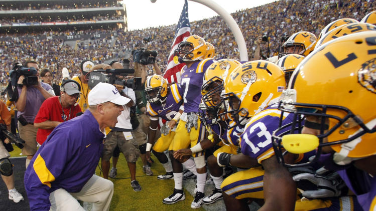 FILE - In this Sept. 20, 2011 file photo, LSU coach Les Miles talks to his players before taking the field for an NCAA college football game against Northwestern State in Baton Rouge, La.  The Tigers are ranked third in the Associated Press preseason college football poll released on Saturday, Aug. 18, 2012. (AP Photo/Gerald Herbert, File)