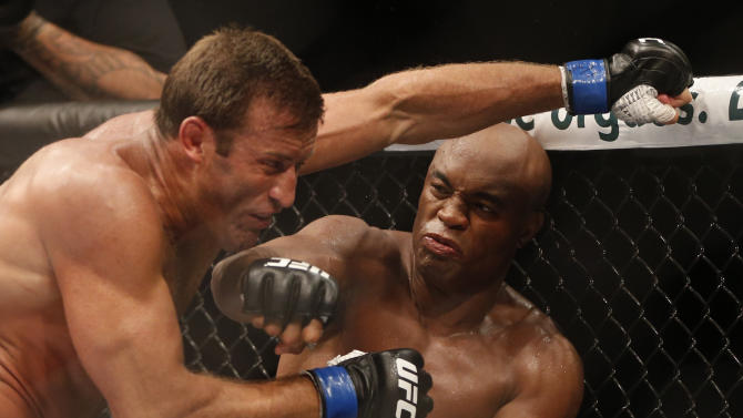 Anderson Silva lands a punch on Stephan Bonnar's head during their light heavyweight fight at UFC 153. (AP)
