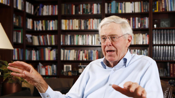 "FILE- In this May 22, 2012, file photo, Charles Koch speaks in his office at Koch Industries in Wichita, Kan. Koch, a billionaire industrialist, warned America is ""done for"" if the conservative donors and politicians he gathered at a retreat this weekend don't rally others to their cause of demanding a smaller, less-intrusive government. (Bo Rader/The Wichita Eagle via AP, File) LOCAL TELEVISION OUT; MAGS OUT; LOCAL RADIO OUT; LOCAL INTERNET OUT; MANDATORY CREDIT"