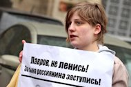 Anastasiya Rybachenko takes part in an opposition rally in Moscow last year. Rybachenko&#39;s university expelled her after a police visit and she has enrolled in a university in Tallinn