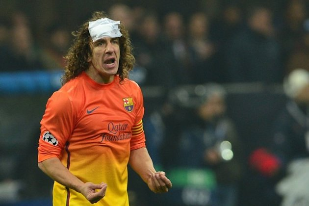 Carles Puyol plays for Barcelona in a Champions League game against AC Milan at San Siro stadium on February 20, 2013