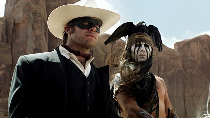 """This undated publicity photo from Disney/Bruckheimer Films, shows actors, Johnny Depp, left, as Tonto, a spirit warrior on a personal quest, who joins forces in a fight for justice with Armie Hammer, as John Reid, a lawman who has become a masked avenger in """"The Lone Ranger."""" (AP Photo/Disney/Bruckheimer Films)"""