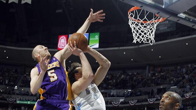 Los Angeles Lakers guard Steve Blake, left, blocks a shot by Denver Nuggets forward Danilo Gallinari, center, of Italy, as Lakers guard Kobe Bryant looks on in the fourth quarter of the Lakers' 92-88 victory in Game 4 of the teams' first-round NBA  basketball series in Denver on Sunday, May 6, 2012. (AP Photo/David Zalubowski)