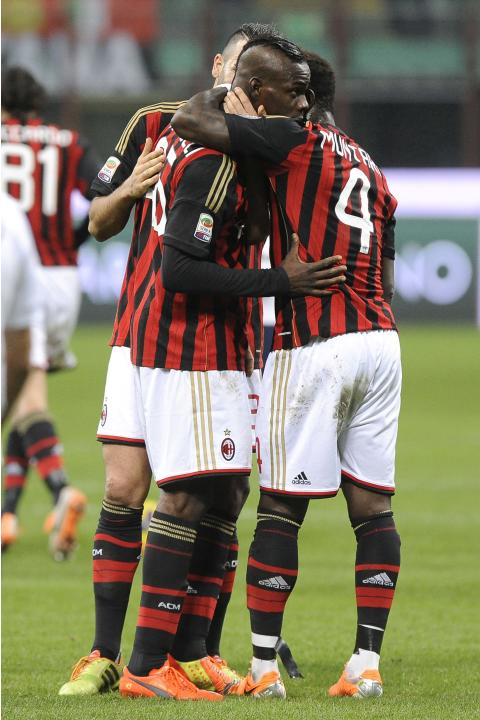 AC Milan's Balotelli celebrates with his teammates Rami and Muntari after scoring against Bologna during their Italian Serie A soccer match at San Siro Stadium in Milan