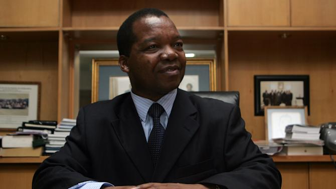 Zimbabwean economist John Mangudya who was appointed central bank governor poses in his office on March 24, 2014 in Harare