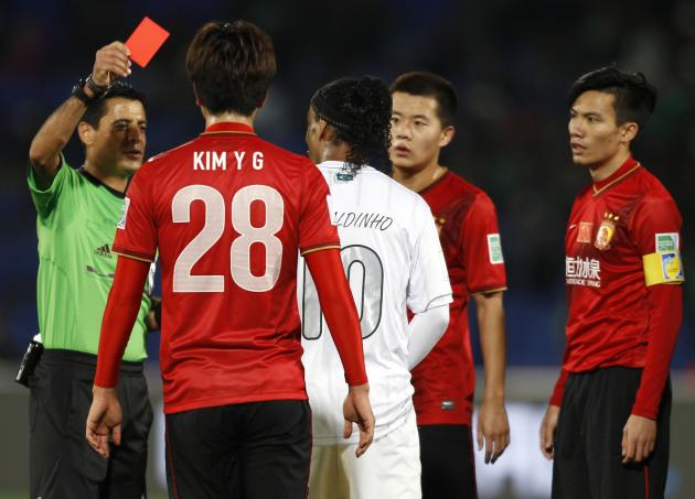 Ronaldinho of Brazil's Atletico Mineiro is given a red card by referee Alireza Faghani during their 2013 FIFA Club World Cup third place soccer match against China's Guangzhou Evergrande in Ma