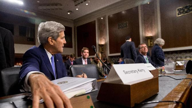 From left, Secretary of State John Kerry, Defense Secretary Ash Carter and Energy Secretary Ernest Moniz prepare to testify on Capitol Hill in Washington, Wednesday, July 29, 2015, before the Senate Armed Services Committee hearing on the impacts of the Joint Comprehensive Plan of Action (JCPOA) on U.S. Interests and the Military Balance in the Middle East. (AP Photo/Andrew Harnik)