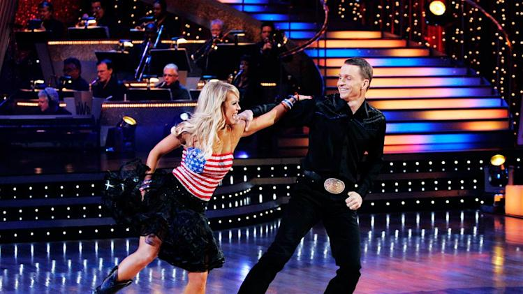 "Ty Murray and Chelsie Hightower perform the Rumba to ""The Girl's Gone Wild"" by Travis Tritt on ""Dancing with the Stars."""