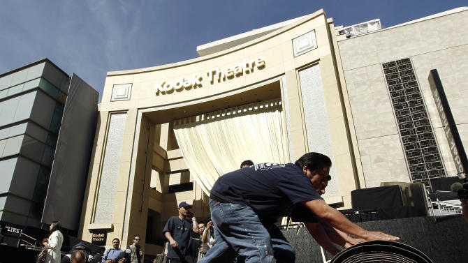 Workers roll out the red carpet that will be used for the 84th Academy Awards in Los Angeles, Wednesday, Feb. 22, 2012.  The Academy Awards will be held Sunday, Feb. 26, 2012. (AP Photo/Matt Sayles)