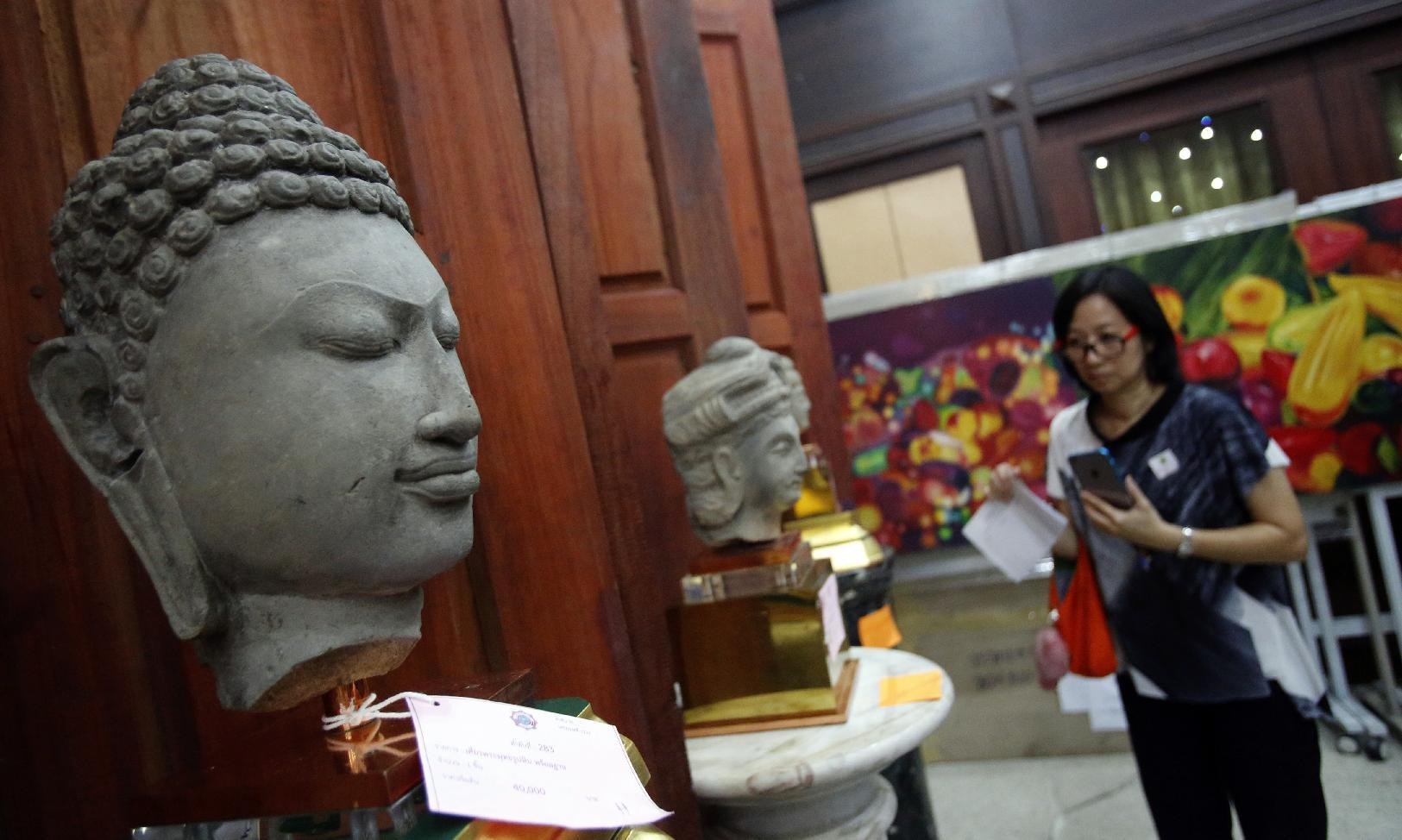 Art, fine wine: Thai auction puts police corruption on view