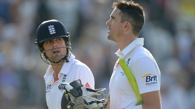 England's captain Alastair Cook (L) and Kevin Pietersen leave the field at the end of the day's play in the first Ashes cricket test match against Australia at Trent Bridge cricket ground in Nottingham, England July 11, 2013 (Reuters)