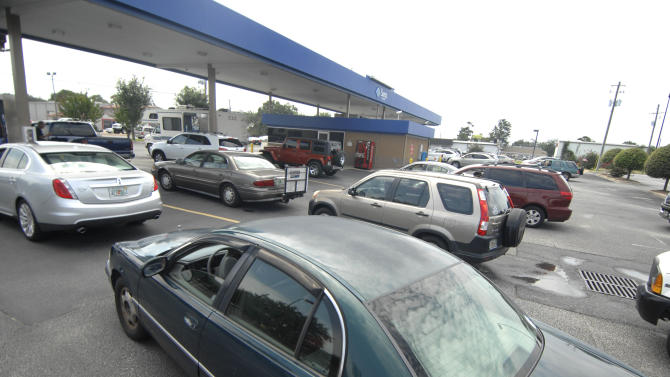 Vehicles wait in line for gasoline at the Sam's Club gas station in Fort Walton Beach, Fla., Saturday August 25, 2012 in preparation for Tropical Storm Isaac which is forecasted to make landfall in the Florida Panhandle as a hurricane on Tuesday. (AP Photo/Northwest Florida Daily News, Nick Tomecek)