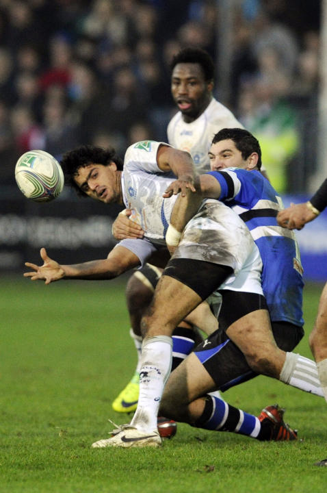 Bath's Stephen Donald, right, tackles Montpellier's Fulgence Ouedraogo during their Heineken Cup pool 3 rugby match at the Recreation ground, Bath, England, Sunday, Nov. 20, 2011. (AP Photo/Tom Hevezi