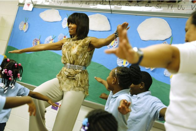 U.S. first lady Obama balances on one leg as she exercises with pre-kindergarten children at the Savoy School