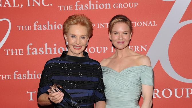 """""""Superstar Award"""" honoree, designer Carolina Herrera, left, poses with actress Renee Zellweger at the 29th Annual """"Night Of Stars"""" presented by The Fashion Group International at Cipriani Wall Street on Thursday Oct. 25, 2012 in New York. (Photo by Evan Agostini/Invision/AP)"""