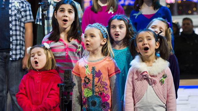 """Children from Newtown, Conn. and Sandy Hook Elementary school perform """"Somewhere Over the Rainbow"""" on ABC's """"Good Morning America"""" on Tuesday, Jan. 15, 2013 in New York. The Children who survived last month's shooting rampage, recorded a version of """"Over the Rainbow"""" to raise money for charity.  They recorded the song at the home of two former members of the Talking Heads rock band. It went on sale Tuesday on Amazon and iTunes, with proceeds benefiting a local United Way and the Newtown Youth Academy. (Photo by Charles Sykes/Invision/AP)"""