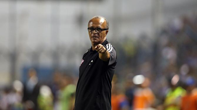 Coach Jayme de Almeida from Brazil's Flamengo gives instructions from the sidelines of a Copa Libertadores soccer match with Ecuador's Emelec in Guayaquil, Ecuador, Wednesday, April 2, 2014