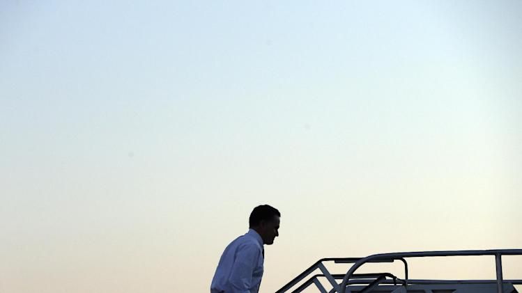 Republican presidential candidate and former Massachusetts Gov. Mitt Romney boards his plane at Washington Dulles International Airport in Sterling, Va., Monday, Nov. 5, 2012, en route to Columbus, Ohio. (AP Photo/Charles Dharapak)