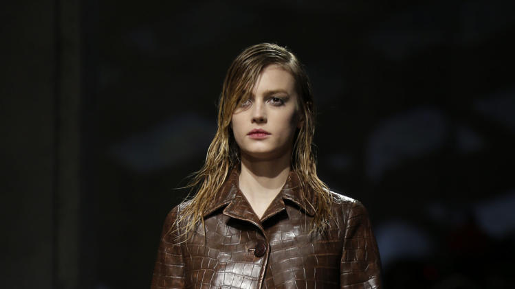 A model wears a creation for Prada women's Fall-Winter 2013-14 collection, part of the Milan Fashion Week, unveiled in Milan, Italy, Thursday, Feb. 21, 2013. (AP Photo/Luca Bruno)