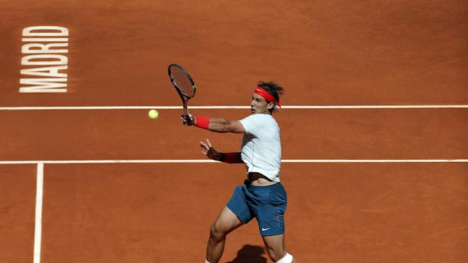 Rafael Nadal from Spain returns the ball during the match against Mikhail Youzhny from Russia at the Madrid Open tennis tournament, in Madrid, Thursday, May 9, 2013. (AP Photo/Andres Kudacki)
