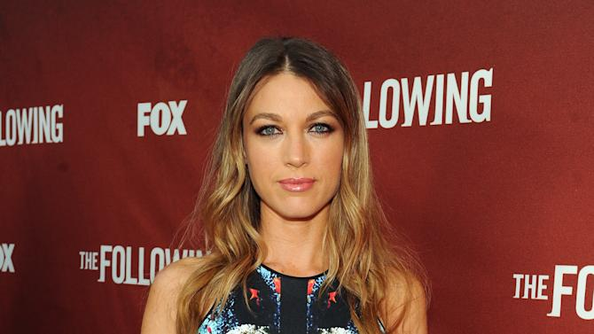 "Actor Natalie Zea arrives at FOX's ""The Following"" finale screening at the Academy of Television Arts & Sciences' Leonard H. Goldenson Theater on Monday, April 29, 2013 in North Hollywood, California. (Photo by Frank Micelotta/Invision for FOX/AP Images)"