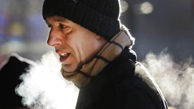 A man is bundled up against the cold on New York's 34th Street in Midtown Manhattan Wednesday, Jan. 23, 2013. The temperature was around 12 degrees, but with wind gusts of 15-20 mph, it felt more like five below as people started their day in New York City. (AP Photo/Mark Lennihan)